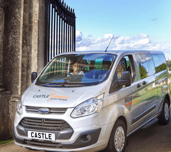Castle Minibus driving through gates