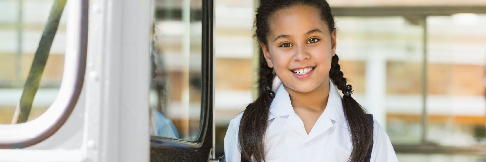 Castle Minibus' website home page header image of school girl smiling to camera